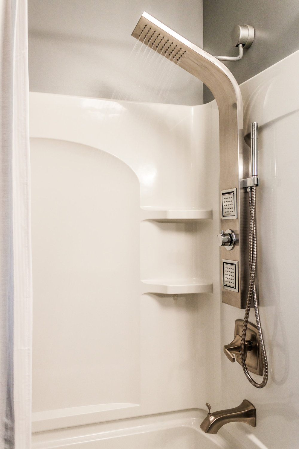 - Even a humble acrylic bath tub shower combo can have an amazing shower tower. This unit is designed to be able to retrofit the standard location.