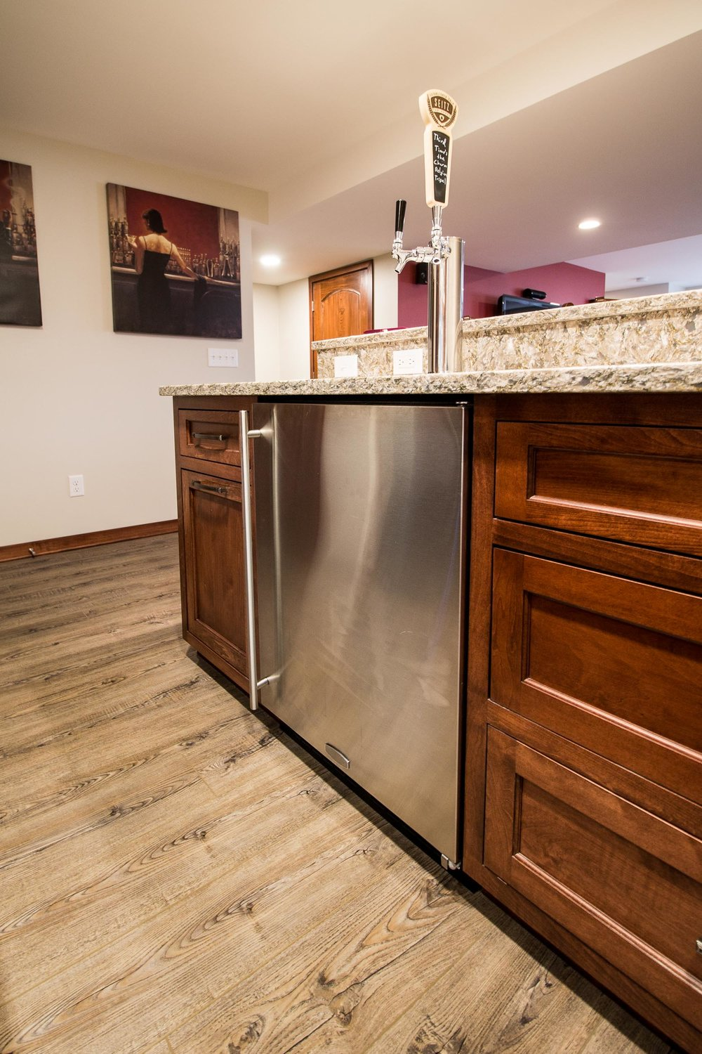- This bar boasts a two-tap kegerator setup in its under counter beverage center.