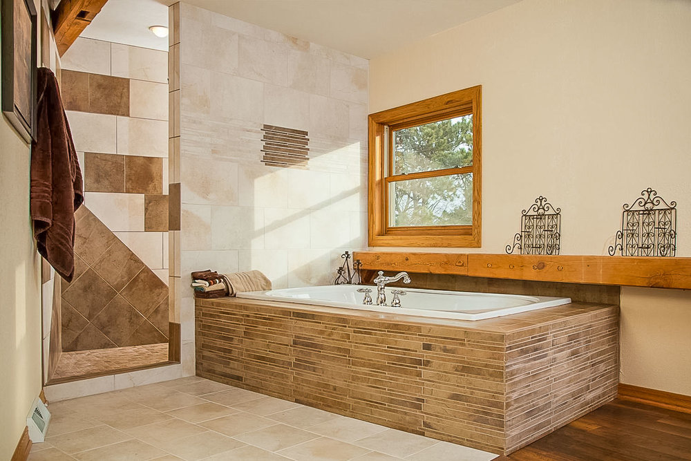 - This one-of-a-kind timber framed home has a one-of-a-kind mosaic created from large format tile in its shower. Meanwhile, a linear mosaic tile forms the tub surround.
