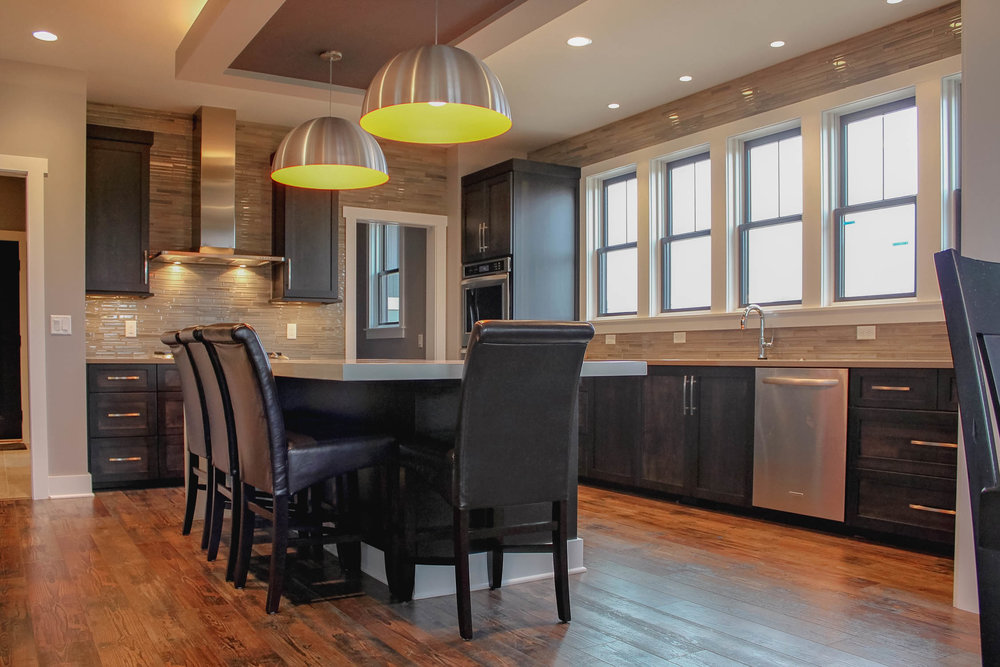 - This kitchen uses multiple sizes of recessed can lighting, as well as reflected uplighting and bold pendants to create flexible, layered and FUNCTIONAL lighting.