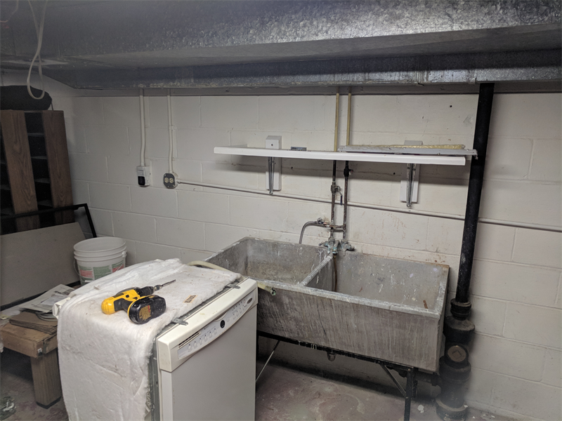 - With a little work and planning, a temporary kitchen can be created in your basement or laundry room. In this case, the dishwasher was even hooked up so that it would drain in to the old laundry sink.