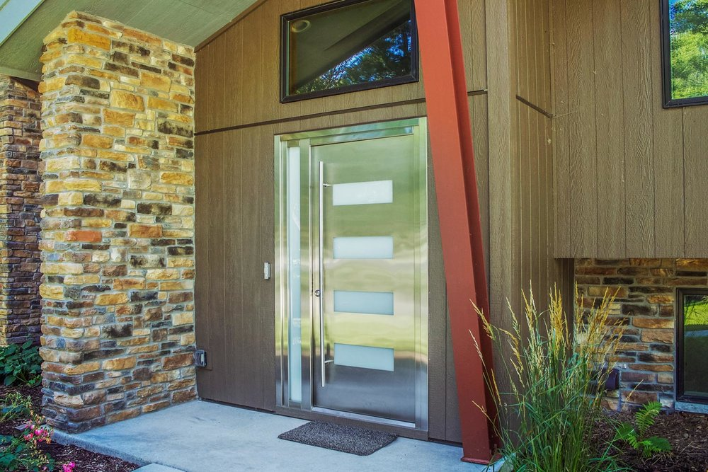 Cultured Stone - This remodeled home features Dutch Quality cast (cultured) stone in the Stack Ledge pattern. The color is blended using a mixture of 90% Sienna color and 10% Autumn Blend color.