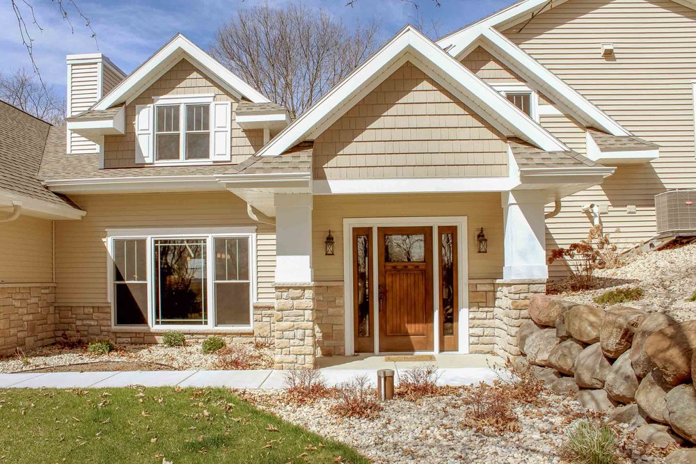Cultured Stone - Ohio White Vein Limestone by Dutch Quality Cultured Stone was chosen for the exterior of this transitional two-story home on the front porch and exterior.