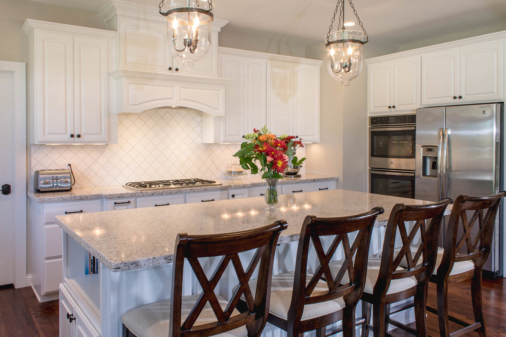 - Sangda Falls quartz by Wilsonart was used in this kitchen, helping to achieve a lighter color appearance instead of using Carrara marble.