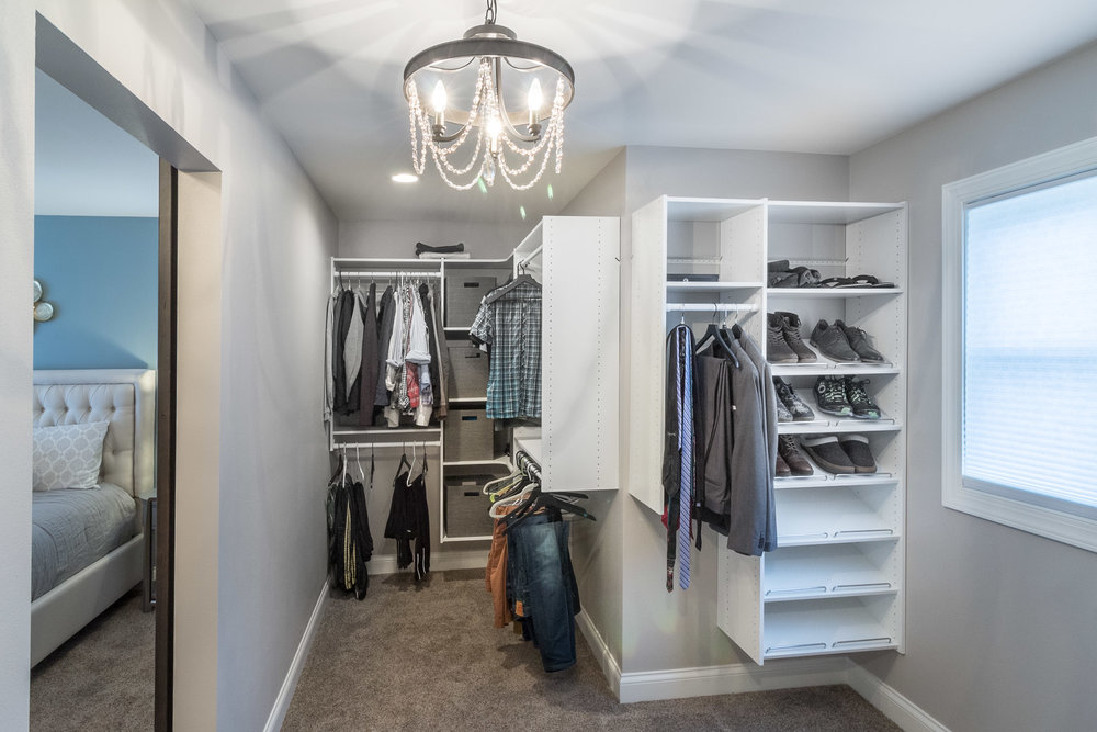 - An irregularly shaped walk-in closet can be a thing of beauty. A large window at the front of the house lights this closet, and because of it's size a chandelier can be used. (Smaller closets cannot use lights with open bulbs due to the fire hazard.)