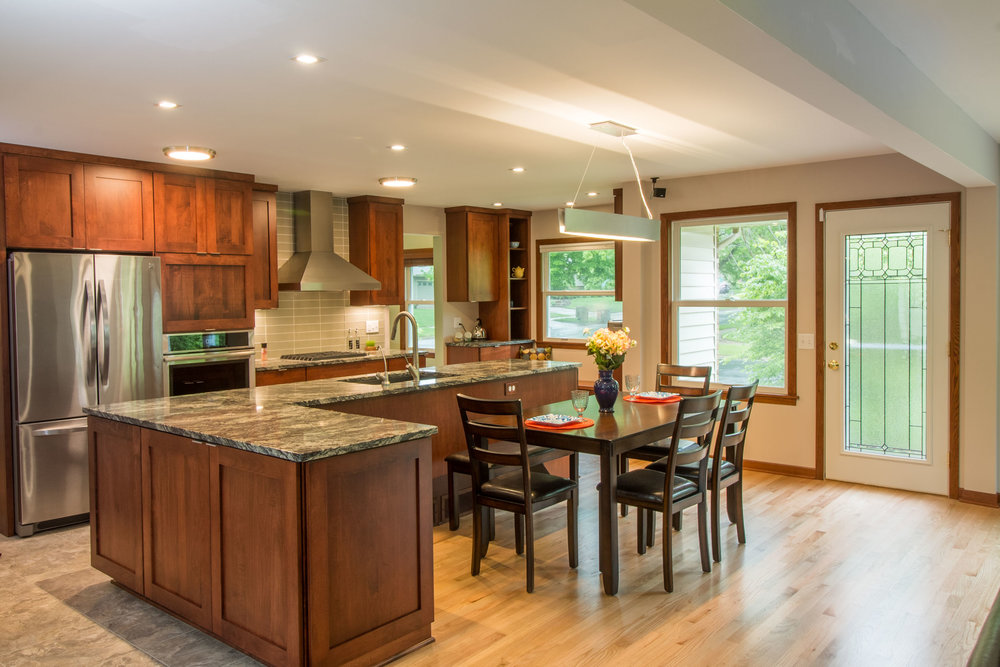 - The big picture: This kitchen design addresses lighting, windows, work triangle, serving food, and connection to the family room. Note with a gas range, a hood is provided for ventilation.