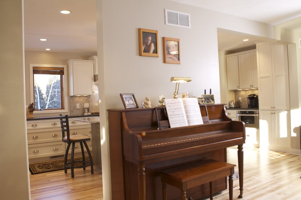 - This remodeled home in Waunakee has a section of loadbearing wall with plumbing and HVAC inside, that provides the perfect visual separation from the front door and a spot for the piano.