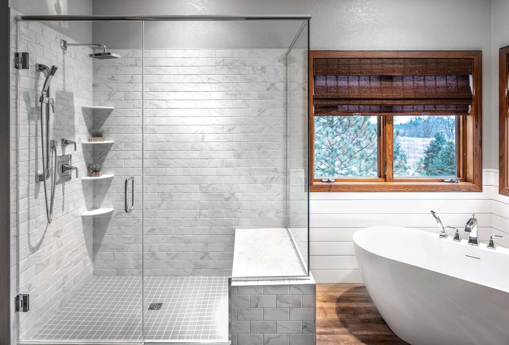 Glass Walled Shower With Seating And Shelves