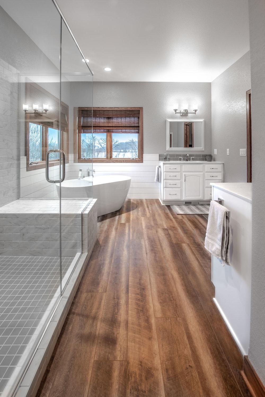 The Bathroom Floor is Luxury Vinyl Plank in Fresco Driftwood
