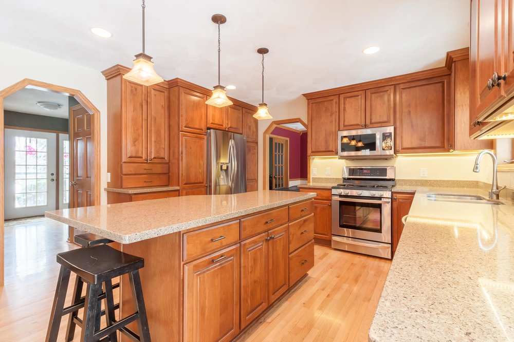 This newly remodeled kitchen has A Kohler Simplice Pull-down faucet and Countryside Cabinets in Maple with soft close drawers.