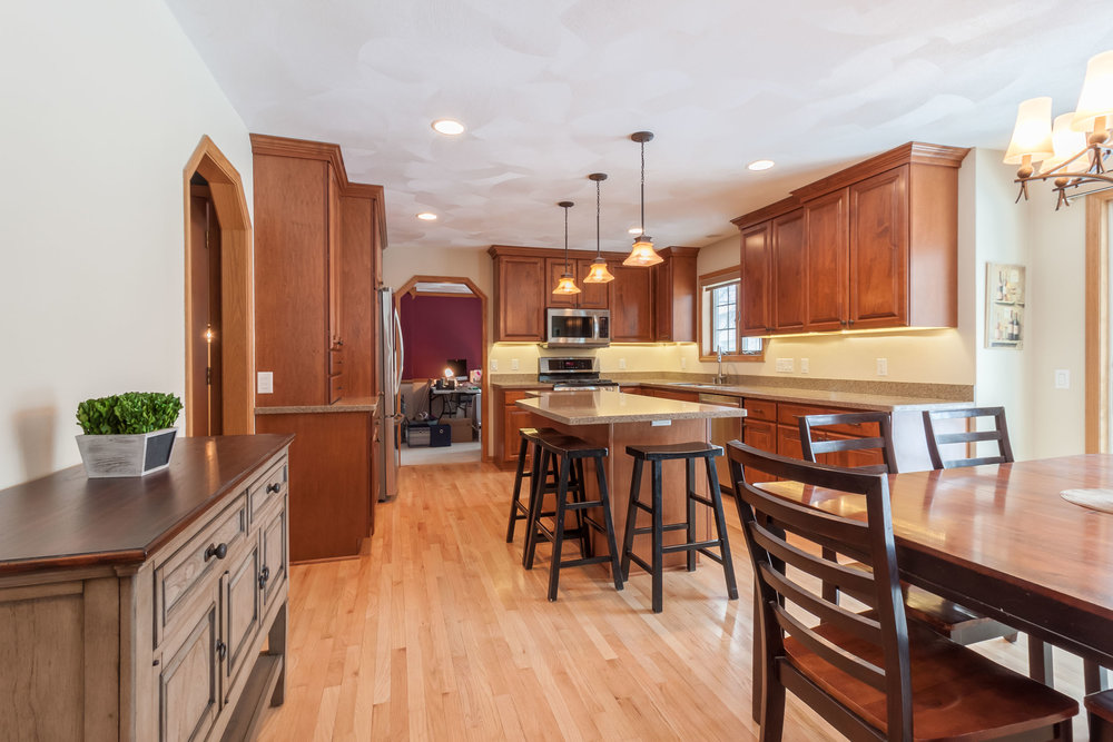 The Countryside Cabinetry is a modified full overlay style in maple with a Harvest finish and Windsor style doors.