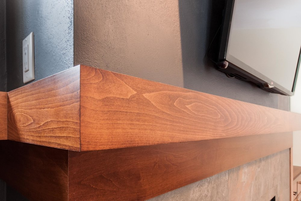A Linear Mantel And Floating Shelves.