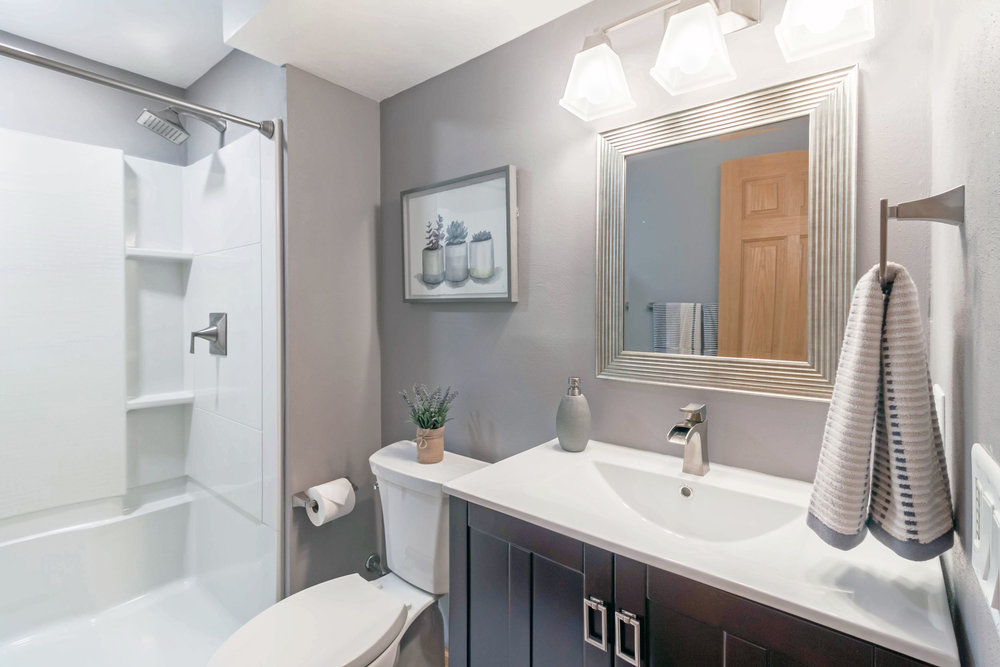 An Old Half-Bath Was Remodeled Into A New Guest Bathroom.