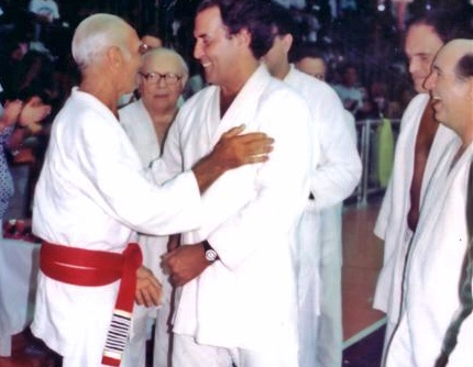 Hélio Vígio being promoted to 9th Degree Red Belt by Grandmaster Helio Gracie surounded by Gastão Gracie, Francisco Mansur and Pedro Valente Sr.