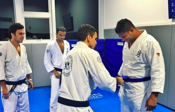 Alistair Overeem being promoted to Blue Belt by brothers Pedro, Gui, and Joaquim Valente