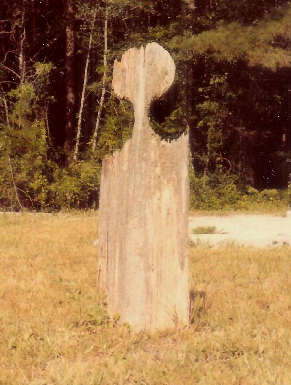 The handmade wooden marker belongs to  Nicholas Word . He was from Ireland and was killed in 1859 while working on the Stumphouse Mountain Tunnel in Oconee County.