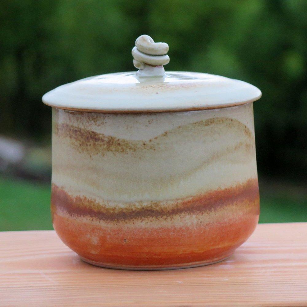 Cov jar with shino and tan-ash glazes-1.jpg