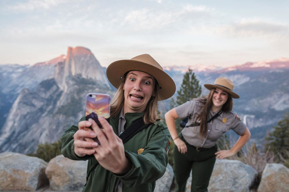 Christina Adele Warburg capturing a selfie with a fellow ranger in the Yosemite National Park.