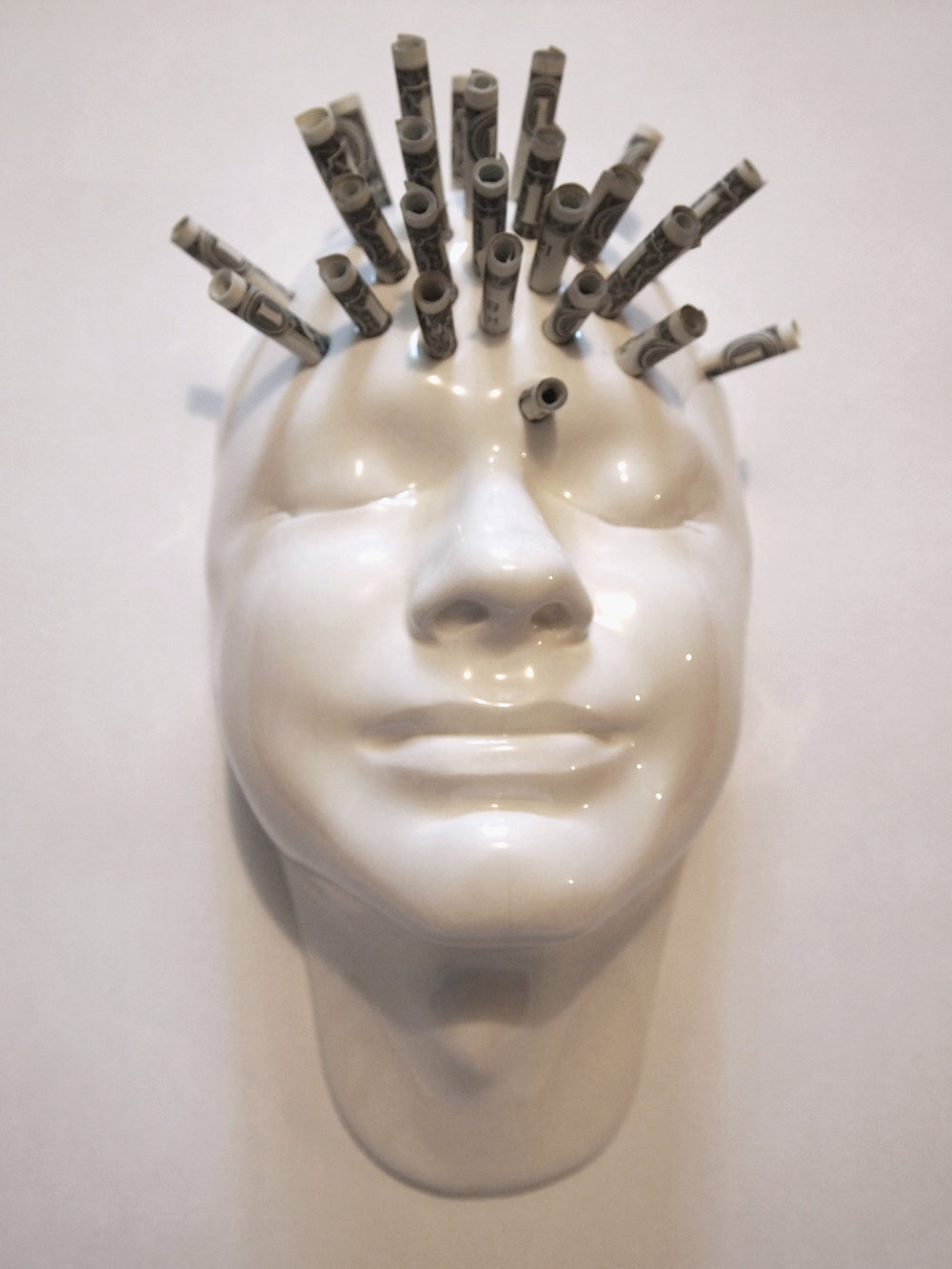 Craig Paul Nowak ceramic face dollar money on mind art sculpture