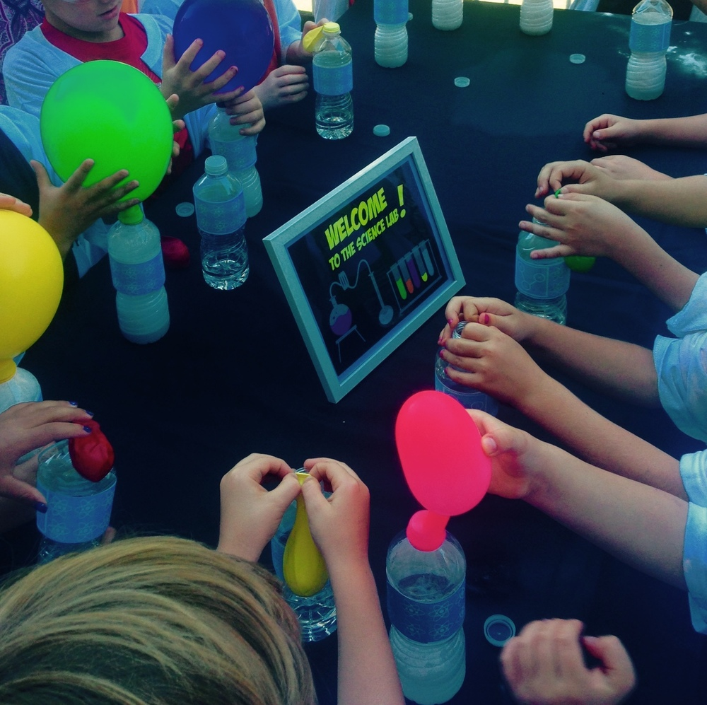 These guests were having a blast conducting their own science experiments at this mad scientist party.