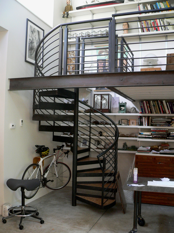steel spiral stair with cork treads.jpg