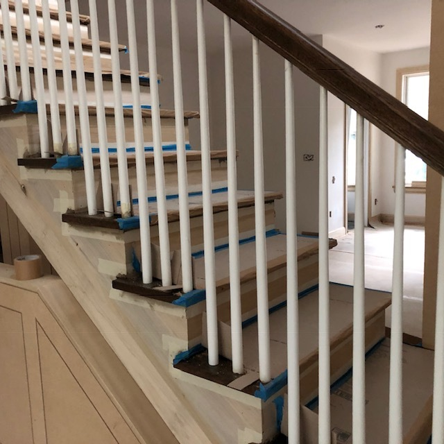 """round """"pool cue"""" balusters just installed on a traditional stair in South Boulder"""