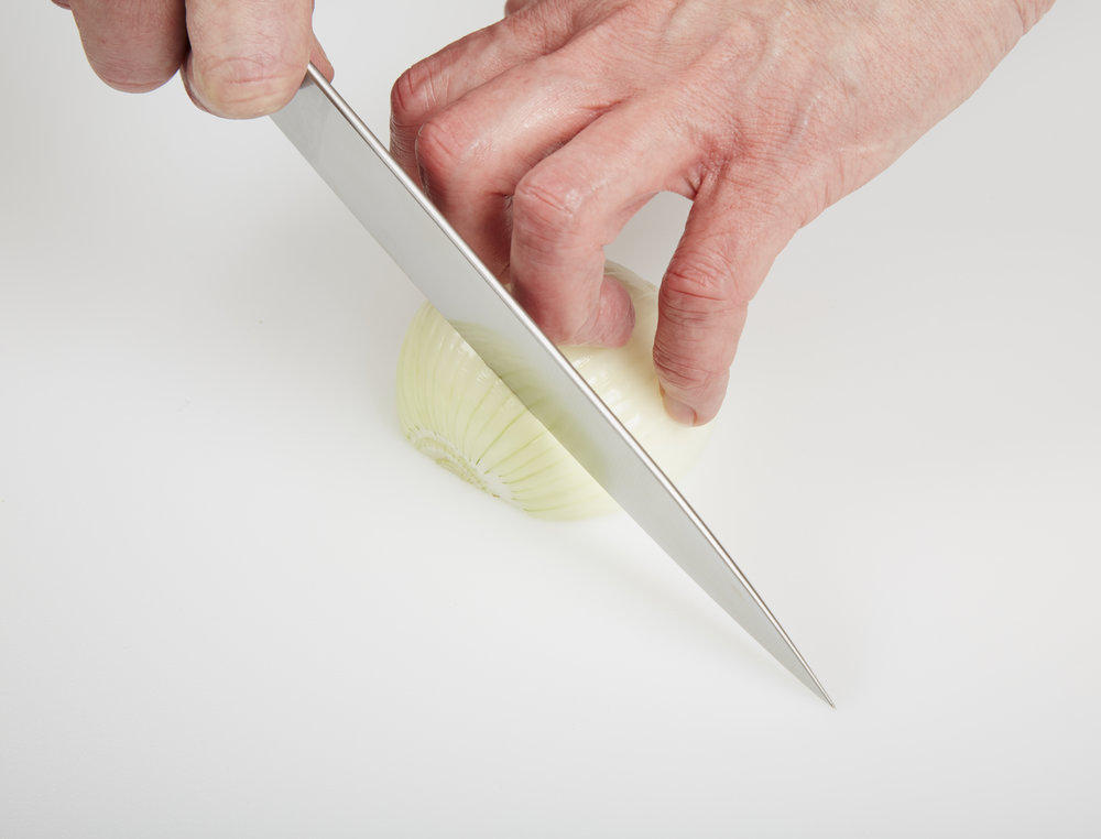 Using a Guide Hand to Cut an Onion