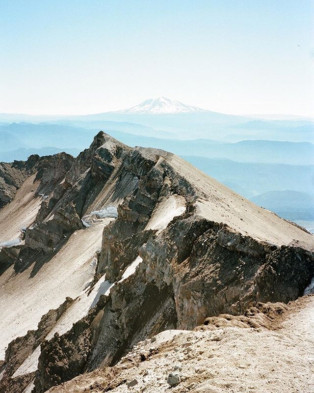 Mt Adams peeking over the crater rim on the summit of Mt St Helens ⛰