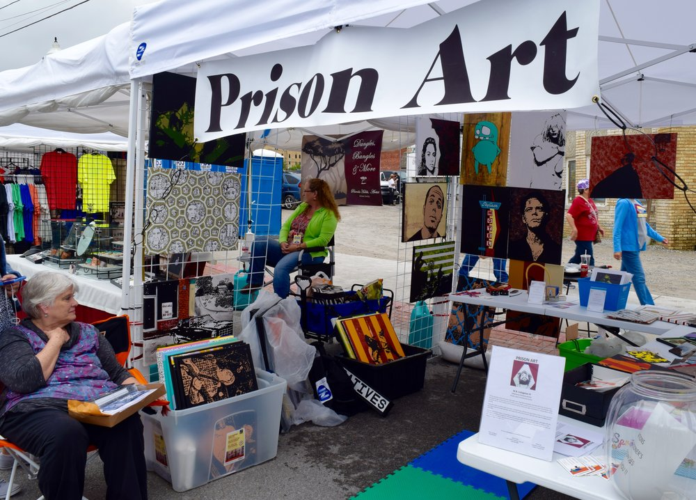 Livingston's parents selling his work. Photograph: Adrian Brune