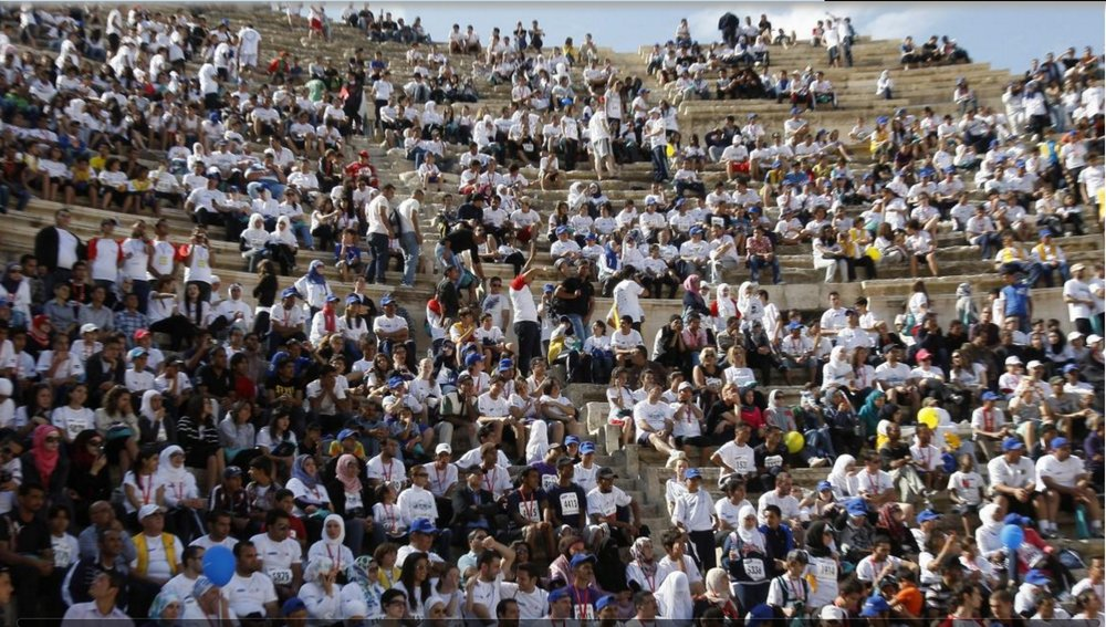 Participants rest at the Roman Ampitheatre after taking part in the third Amman International Marathon in Jordan, October 28, 2011.