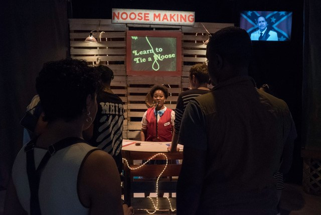 "Audience members learn how to make a noose during the ""Atrocity Carnival.""SOURCE  COURTESY OF 3/FIFTHS / JAMES SCRUGGS"