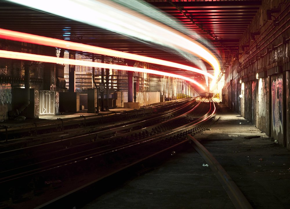 """""""I had a week to get into as much/as little trouble as possible, seeing the Big Apple from its core, the infrastructure that allows it to flow and function. This image shows a section of the subway, and a train flying past me, leaving the underground, to fly over the Manhattan Bridge.""""  COURTESY OF LUCINDA GRANGE"""