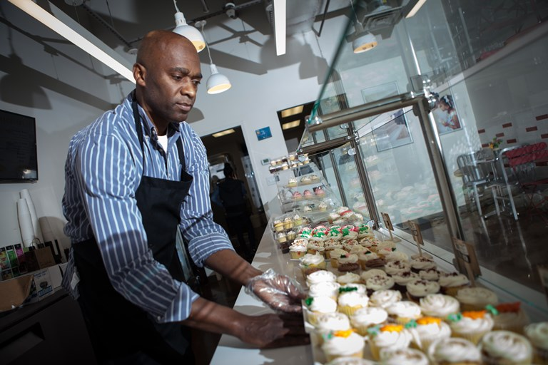 Tonnie Rozier of Tonnie's Minis, a cupcake and sweets bakery located at the Teacher's Village in Newark, New Jersey.SOURCE  LESLIE DELA VEGA/OZY