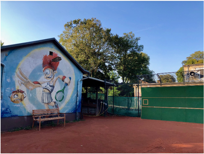 Another photo of T.C. Fredrichshain. The six clay courts and small changing rooms require less upkeep than the courts outside of main Berlin, but Fredrichshain takes care of the maintenance by requiring every member over age 16 to work five hours each season.