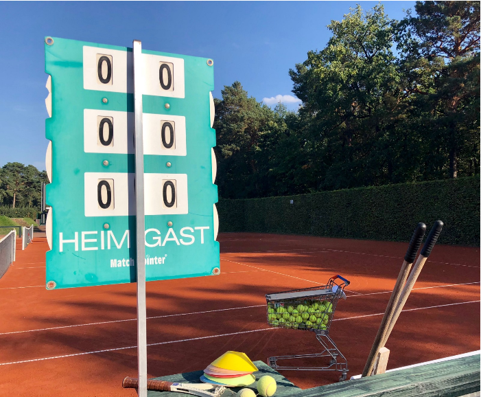 A perfectly manicured clay court at the TC 1899 eV Blau-Weiß with some teaching tools. Considered one of the best tennis clubs in the world, the club boasts Boris Becker as its most highly regarded member — its dining room holds his trophies, as well as dozens from the generations training there after him.
