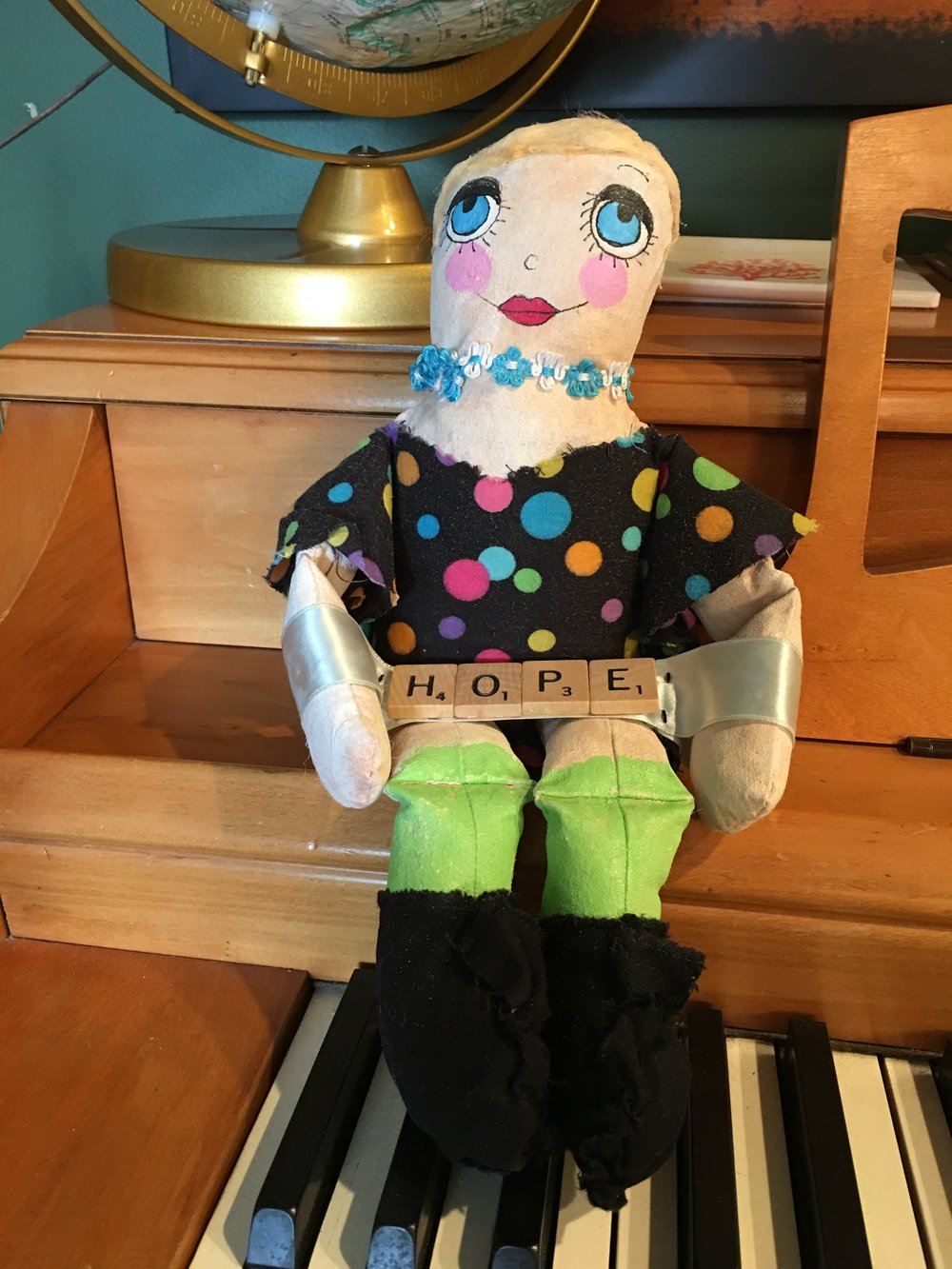 I found this in my mailbox about one hour after I wrote this post, I guess Breast Cancer is totally inspiring art! Both the painting above and the doll were lovingly made by my dear friend, Micki Rongve!