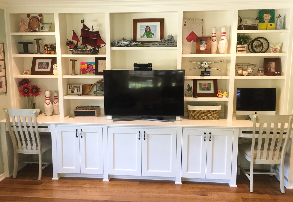 After - these built-ins house a great mix of vintage game items, family photos, and kid creations!