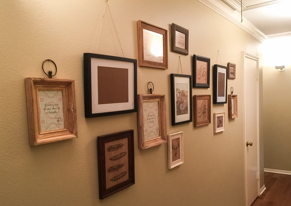 After - a gallery of randomly scattered picture frames of all sizes.