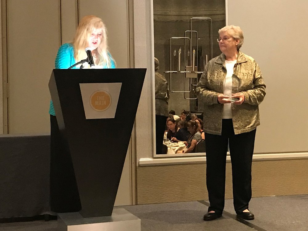 Photo attached: Barbara Coady receives the Trustee Library Award from the Virginia Library Association at their annual banquet.