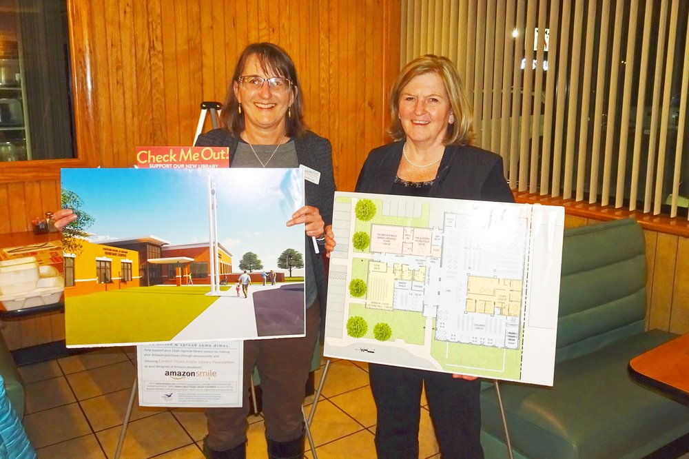 Cara Burton, Library Director (left) and Jeannette Edwards, Soroptimist Officer (right).