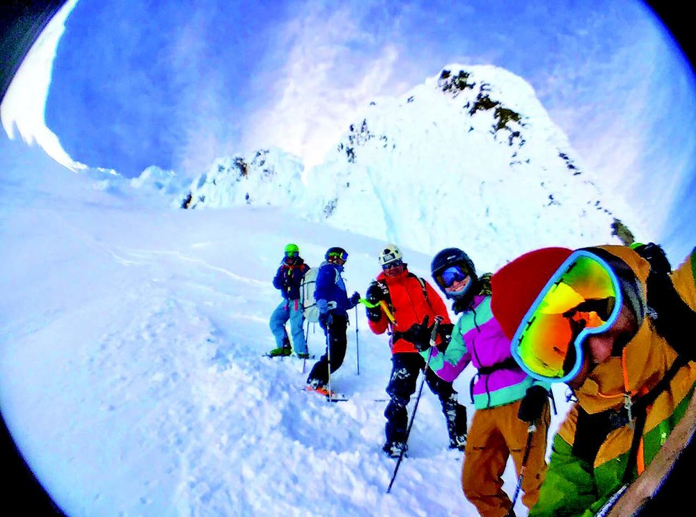 Good friends enjoying two feet of fresh snow from the summit down Leuthold's Couloir (Photo: Asit Rathod)