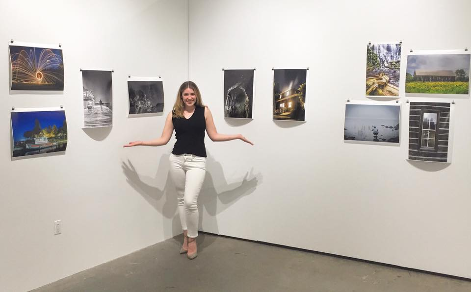 Gabrielle with her ten selected images at the Industry City Gallery.