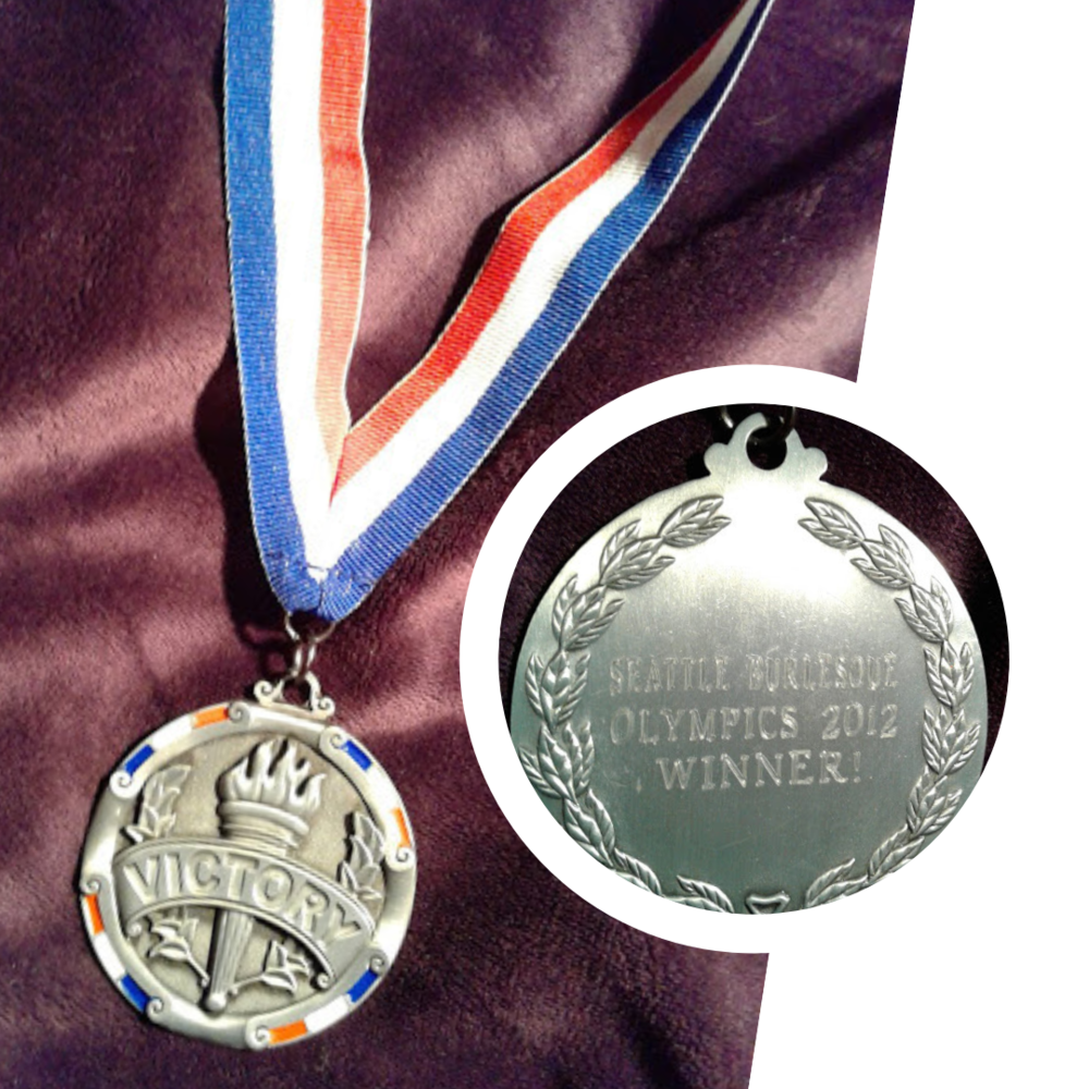 Best Quick Costume Repair - The annual Seattle Burlesque Olympics is a fundraiser for the Burlesque Hall of Fame in Las Vegas. In 2012, I took home the gold medal for Fastest Costume Repair.