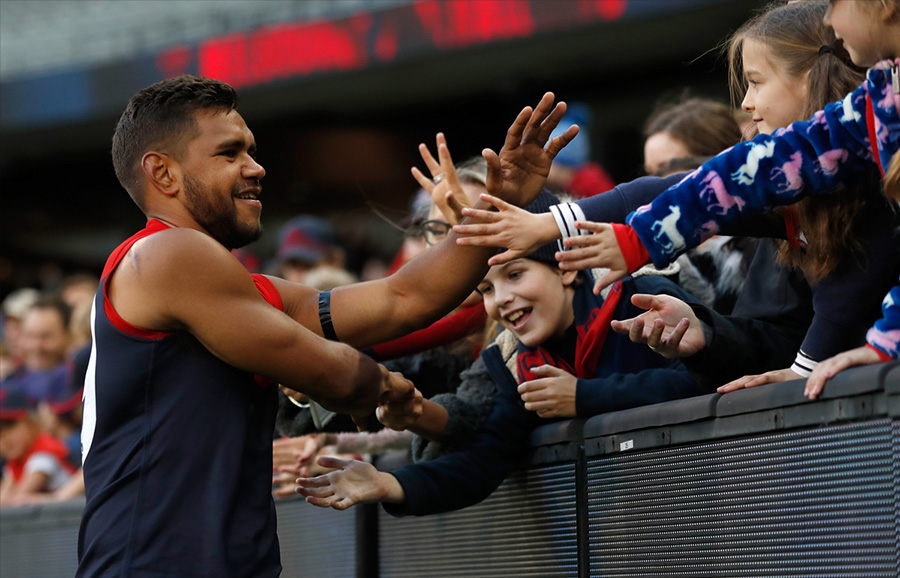 Leading by example: Footballer Neville Jetta gives back to the community