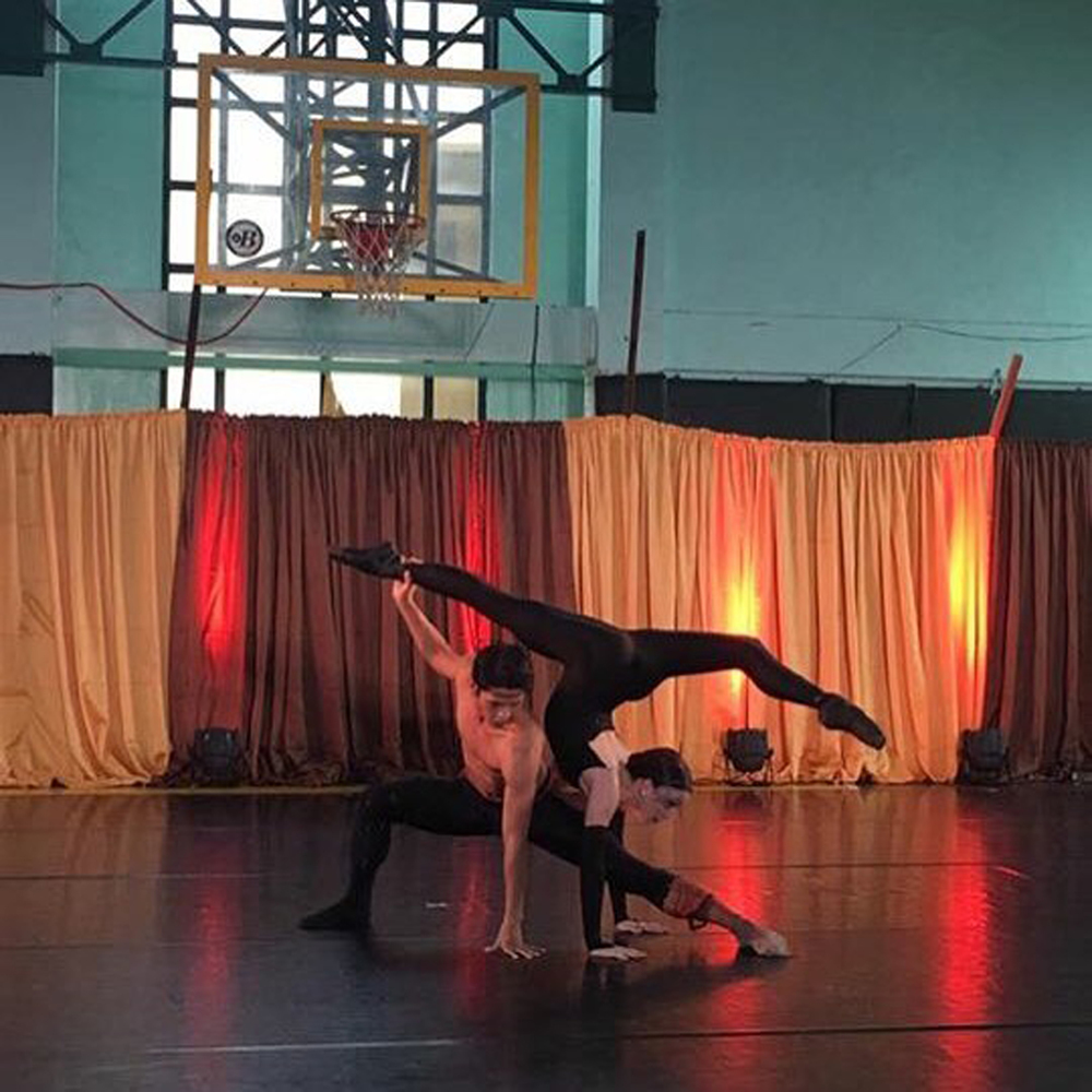 Principal dancers Rudy De Dios and Katherine Barkman perform Agnes Locsin's spider-inspired    Arachnida    in a basketball court.