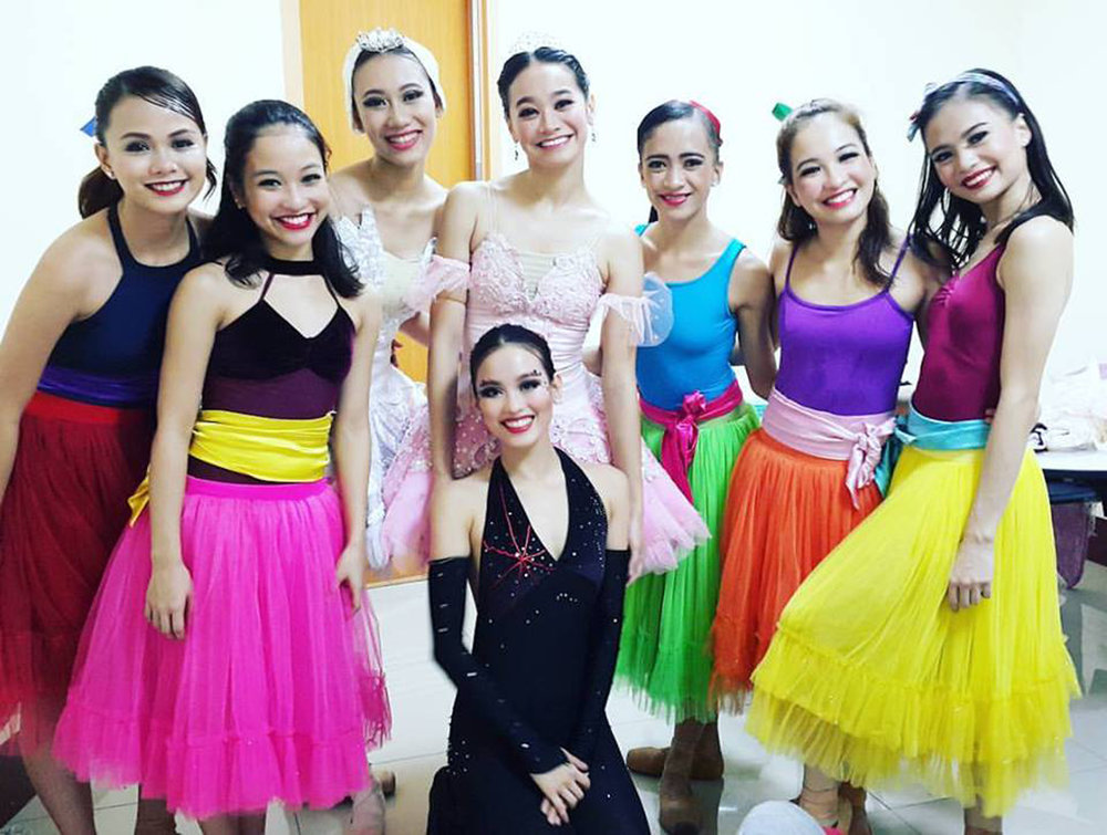 During one of their    Ballet & Ballads    stops: Rissa May Camaclang, Jasmine Pia Dames, Abigail Oliveiro, Dawna Reign Mangahas, Jessa Balote, Jessica Pearl Dames, Ina Villanueva and (foreground) Joan Emery Sia. Photo from Joan Sia's FB page