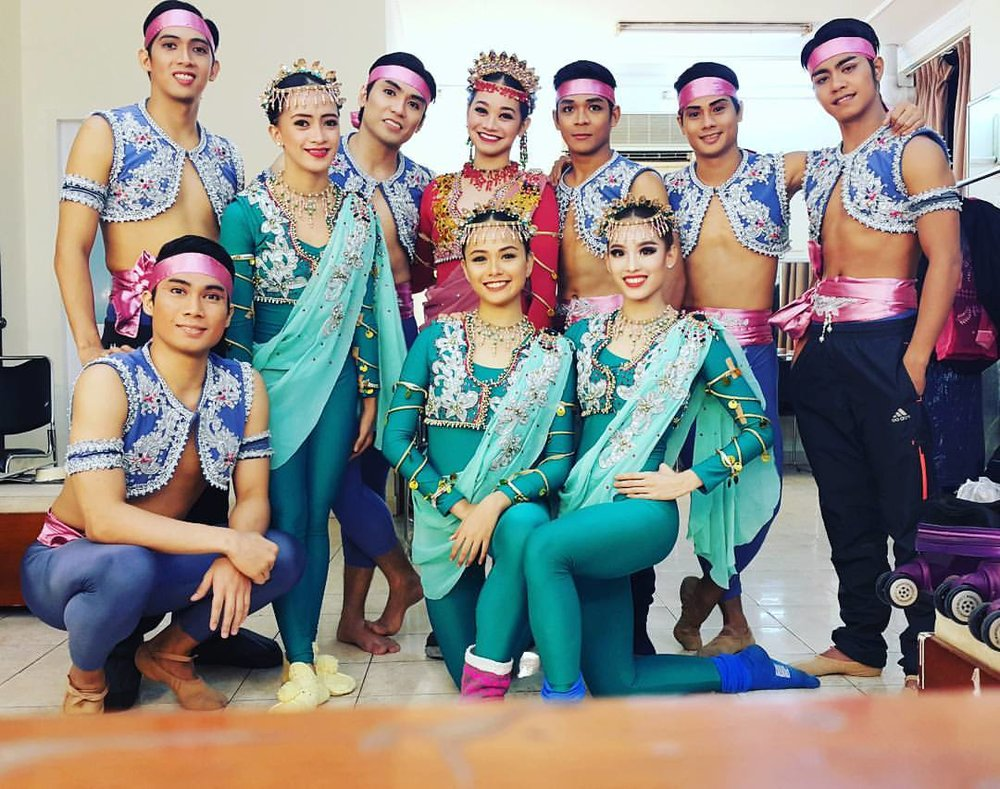 As part of Ballet Manila's Vietnam performance tour last June, Dawna (in red) led the  Sayaw sa Pamlang  cast. Completing the delegation are (standing, from left) Glenn Ragel, Jessa Balote, Romeo Peralta, Gerardo Francisco, Alvin Santos, Anselmo Dictado, (front, from left) John Ruiz de Luzuriaga, Rissa May Camaclang and Joan Emery Sia. Photo from Joan Sia's Facebook page