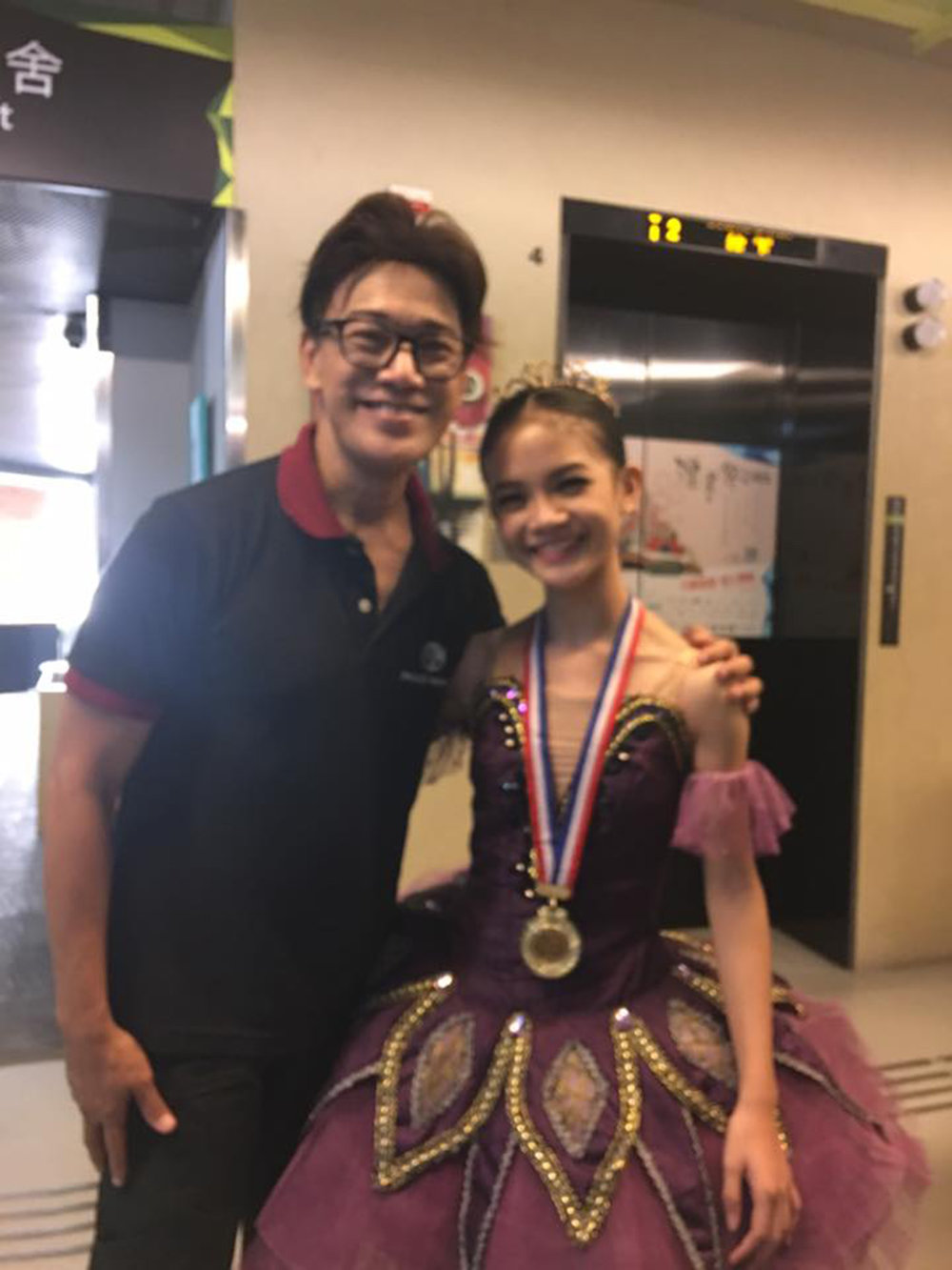 Celebrating with her mentor Osias Barroso outside the Y-Theater in Hong Kong, shortly after the AGP awarding rites. Photo from Osias Barroso's Facebook page