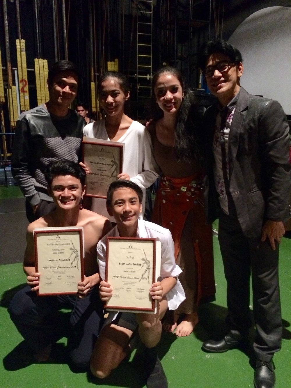 Ballet Manila co-artistic director Osias Barroso (standing, rightmost) congratulates the winners and special awardees backstage: (standing, from left) Gerardo Francisco, Nicole Barroso, Marinette Franco, (kneeling, from left) Joshua Enciso and Brian Sevilla. Photo by Giselle Kasilag