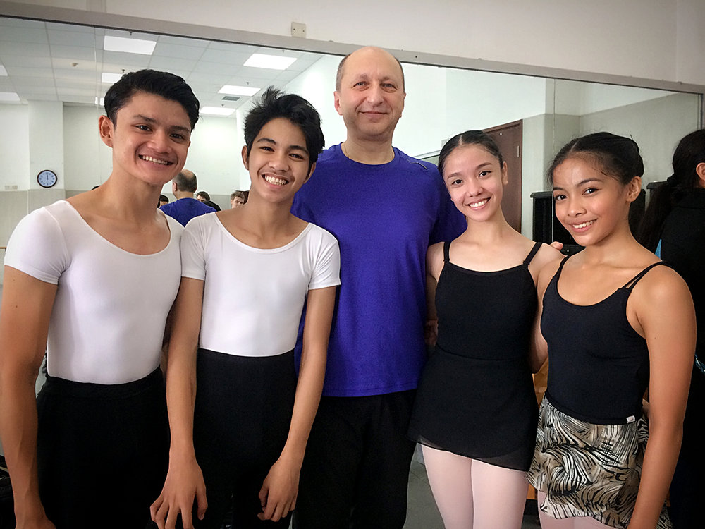 The dancers pose with Eldar Aliev, master choreographer of the Mariinsky Ballet, after taking Vaganova Ballet Technique class with him. Photo courtesy of Gerardo Francisco